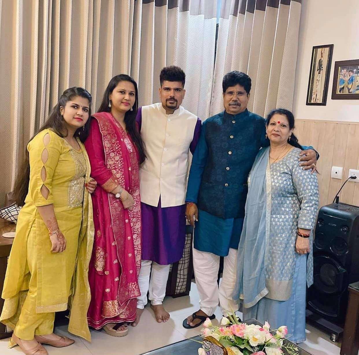 Karn Sharma with his family